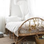 Rattan Bed Frame With Foot Board Woven Rug Two Woven Baskets White Draperies White Bed Drapery