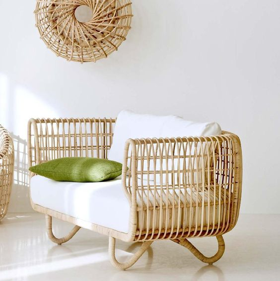 rattan chair with hairpin legs and white foamy cushion green throw pillow