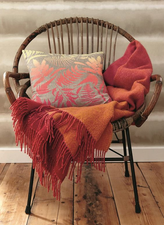 rattan lounge chair in shabbier living coral throw blanket with ornate tassels