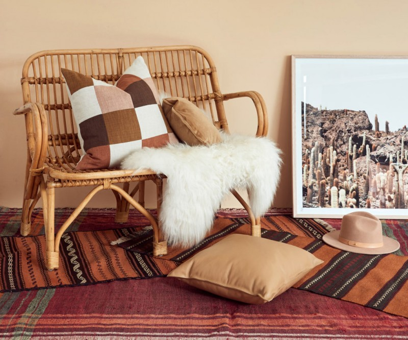 rattan lounge chair white shag throw blanket white and earthy brown throw pillow multicolored runners and area rug
