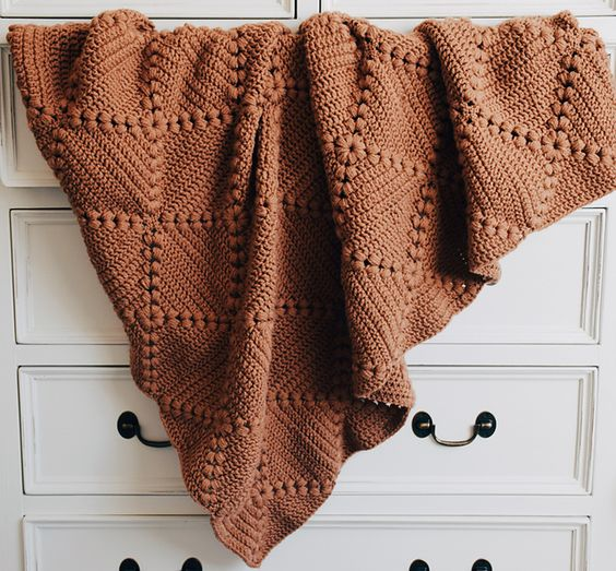 rust colored crochet throw blanket