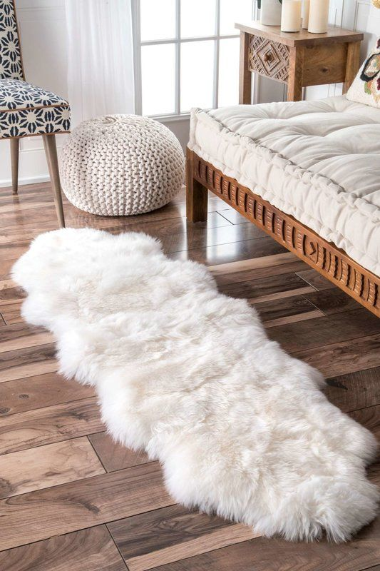 sheepskin mat in white wood plank floors