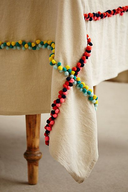 simple table cloth with crossing lines of colorful pom pom