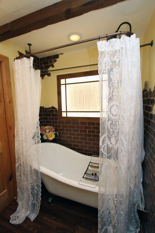 small bathroom white bathtub white lace shower curtains with black metal rods