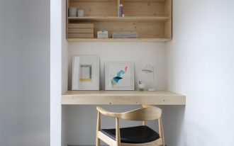 small private workspace in Scandinavian style light wood floating desk recessed book shelves midcentury modern chair