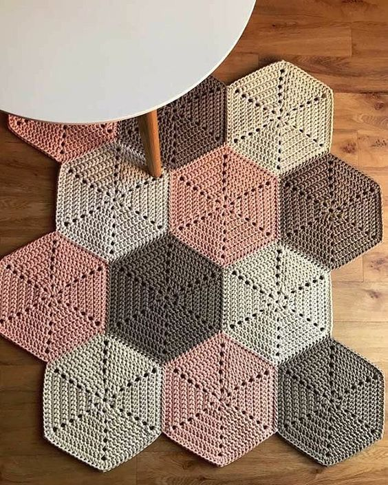 soft colored crochet rug in asymmetric shape