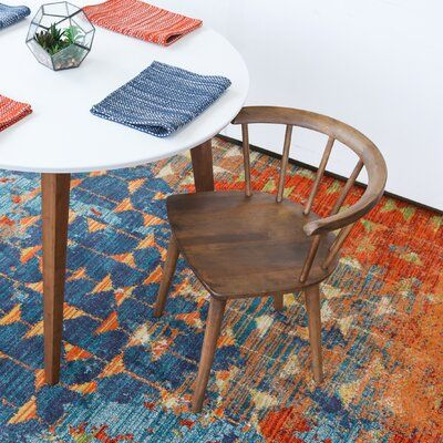 solid wood chair by AllModern white round top table with wood legs colorful area rug