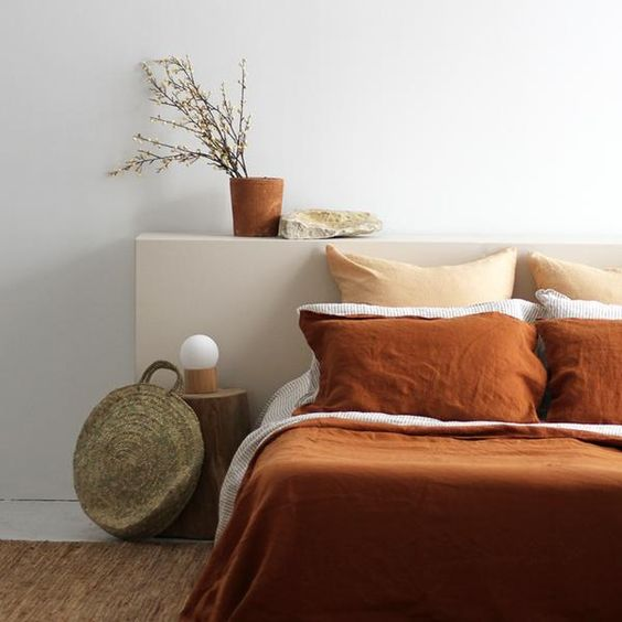 terracotta duvet cover cream pillows white walls terracotta clay planter