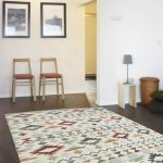 Vintage Rug With Colored Geometric Patterns