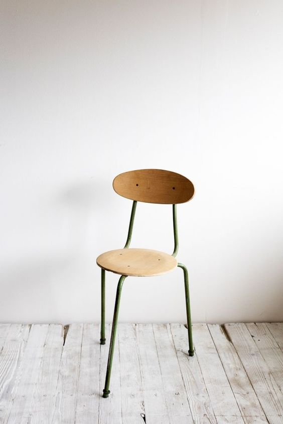 vintage style chair made of metal frame and solid wood seat and back rest