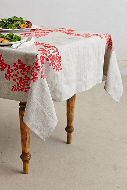 white table linen with red flower motifs in some particular spots