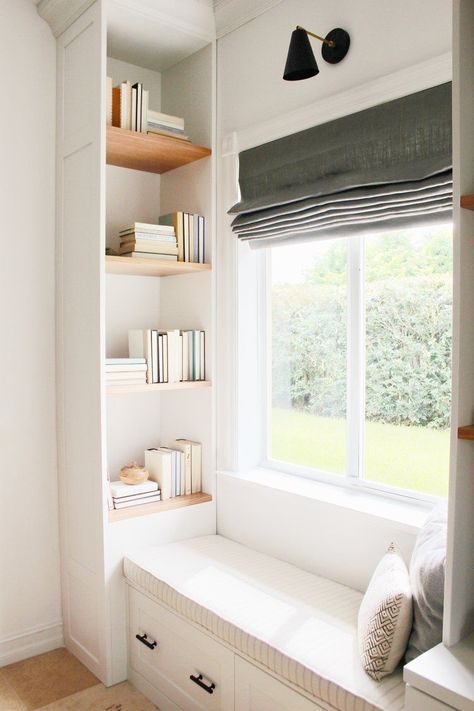 window seat reading nook supported with cozy cushion pillows clean look bookshelves and under storage solution
