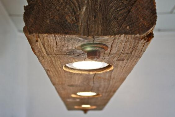 wood beam light fixture idea with recessed round shaped LED