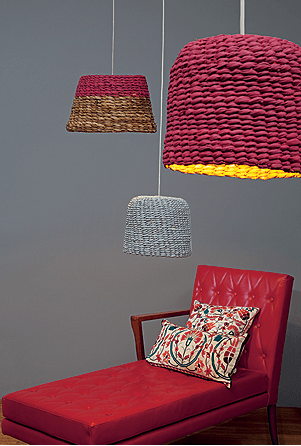 woven basket pendants with bold color lampshades red lounge chair with pillows