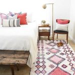 Bohemian Runner With Geometric Patterns Chair With Pillows Rustic Wood Bed Frame Multicolored Pillows With Pom Pom Decorattions