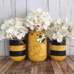 DIY Centerpieces For Table Made From Mason Jars Colored In Black And White Stripes