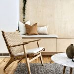 Scandinavian Chair With Cushion Seater Round Marble Top Coffee Table With Wood Legs Textured Gray Area Rug Built In Wood Bench Seat With Neutral Throw Pillows