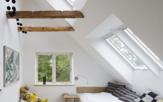 Scandinavian style attic bedroom series of skylight exposed wood beams glass window light wood floors white beanbag with animal stuff