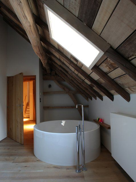 attic bathroom idea Japanese soaking tub in white exposed wood beams with skylight light wood floors