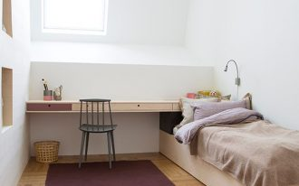 attic kids' bedroom idea single bed frame built in study desk black chair purple rug with fringe trims on both edge sides