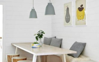 beach style breakfast nook white dining table custom light wood stools bench seat and blue throw pillows blue pendants wood floors