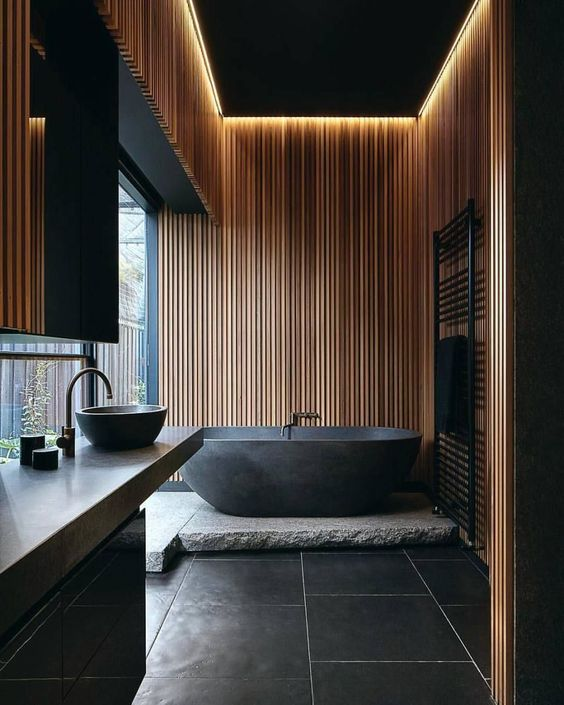 black tiled floors with white grouts stone bathtub's base matte black bathtub black bathroom vanity black ceilings with hidden LED wood cladding panel for walls