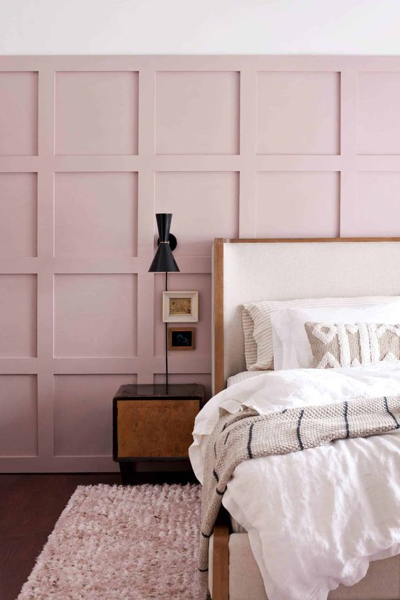 blush pink wood paneling on wall with modern pattern modern minimalist bedside table bed frame with white headboard