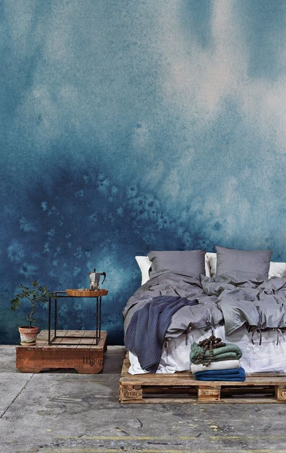 bold and stunning wall mural in blue raw and dark wood platform bed frame