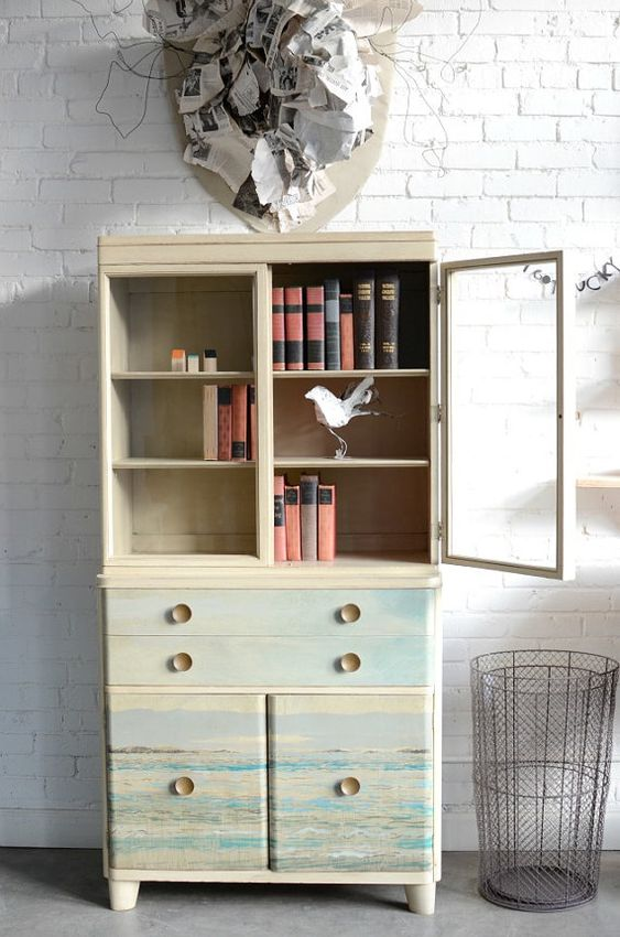 chic vintage storage solution with transparent door panel on top and lightest toned storage sections