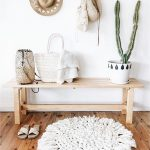 Chic White Round Mat In White Light Wood Bench Seat Ceramic Pot With Green Leaves For Accents Ornate Baskets