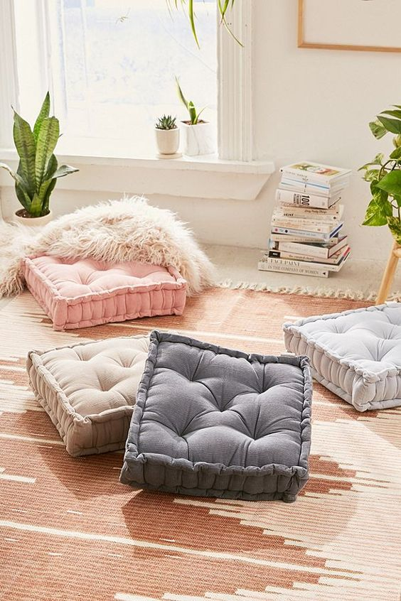 colorful floor pillows with tufted surface