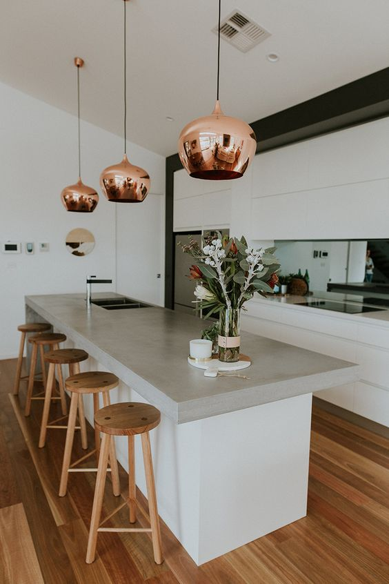 contemporary bar kitchen design concrete benchtop wooden stools copper pendants black and chrome sink wood floors