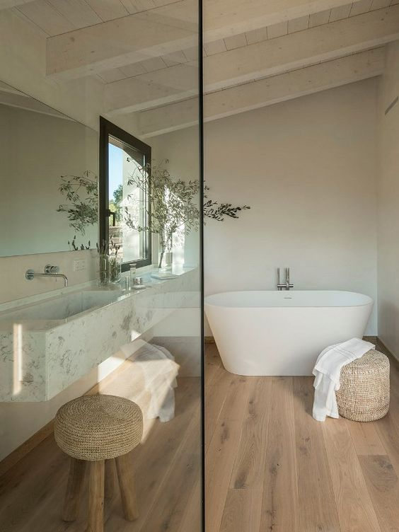 contemporary bathroom idea white bathtub light wood pouf and stool light wood floors whitewashed ceilings and beams white walls