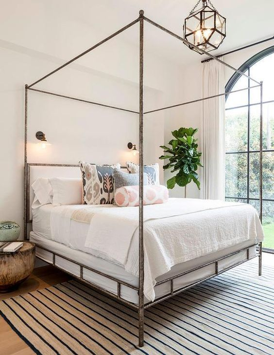 contemporary bedroom design minimalist bed frame with metal canopy striped area rug stunning pendant houseplant