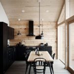 Contemporary Cabin's Interior Oak Plank Walls And Ceilings Concrete Flooring Black Kitchen Countertop And Cabinets Oak Dining Table Black Dining Chairs