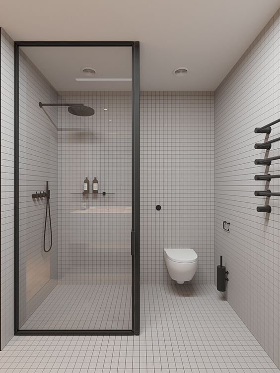 contemporary classic bathroom design clear glass panel with black frame floating toilet classic tile installation for walls and floors