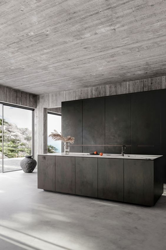 contemporary kitchen with bare concrete walls ceilings floors and kitchen counter