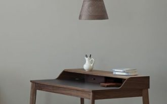 dark wood working table with a single shelving unit dark wood stool modern pendant with dark lampshade