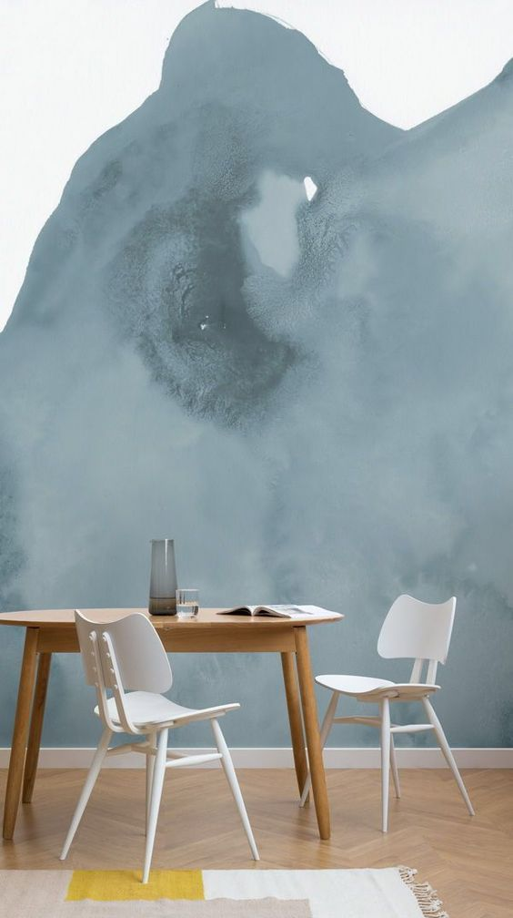 heavy cloud like wall mural breakfast nook consisting of midcentury modern wood dining table white chairs