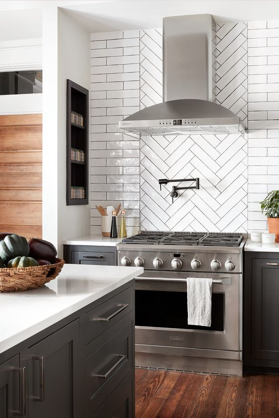 herringbone featuring horizontal subway tiled backsplash