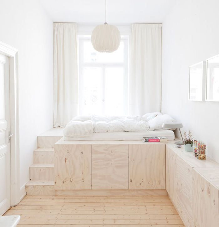 loft bed with staircase white mattress oversized pendant white curtains light wood floors