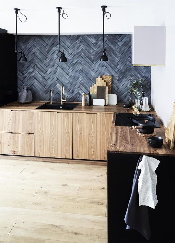 matte black herringbone tiled backsplah wood cabinets and countertop modern industrial ceiling lamps in black