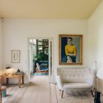 Midcentury Modern Loveseat In White Midcentury Modern Coffee Table Woman Painting With Frame Light Wood Floors