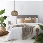 Modern Bed Frame With Gray Headboard White Bed Linen Gray Throw Blanket Pendant With Wicker Lampshade Cover Some Potted Houseplants