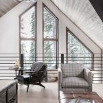 Modern Cabin's Interior Huge Glass Windows Slanted Ceilings Leather Coffee Table