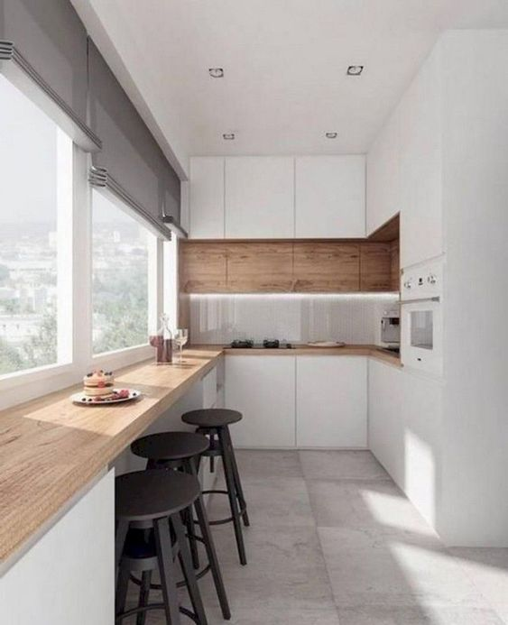 modern clean minimalist kitchen design white kitchen cabinetry glossy white backsplash wood wall paneling wood bar table black finish wood stools concrete floors