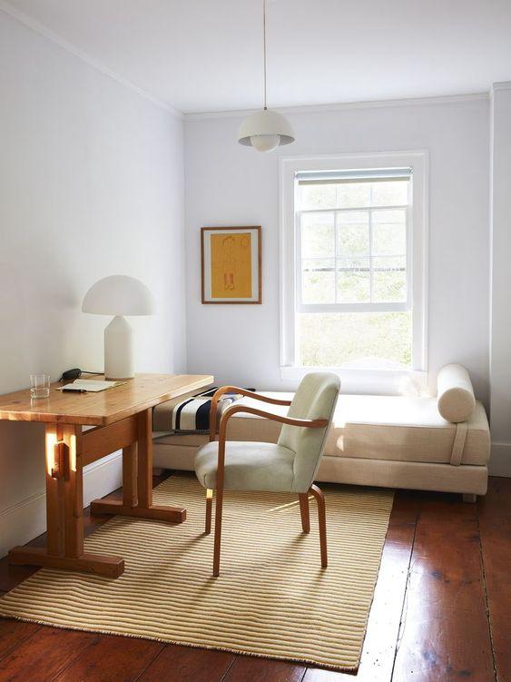 modern white bed frame wooden study desk modern chair with white cushion textured area rug in cream hardwood floors white walls white pendant