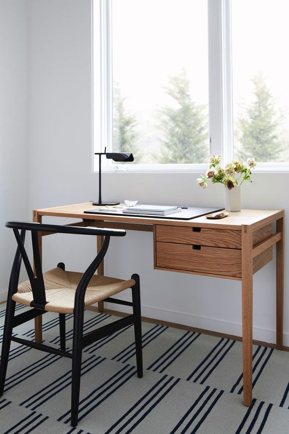 modern wood working desk with under drawing system black iron working chair with cream cushion modern striped area rug