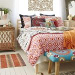 Multilayered Color And Pattern Bed Treatment Wood Bench Bed In Bold Blue With Floral Motifs Multicolored Bed Mat White Wood Plank Floors Carving For Wall Decor