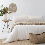 Off White Bedding Treatment With Crochet Throw Blanket Pendant With Woven Lampshade Ornate Woven Basket Round Shaped Crochet Rug In Cream Round Top Bedside Table With Tripod Legs